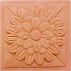 handmade terra cotta ceramic tile with a high relief design and a clear matte or gloss glaze