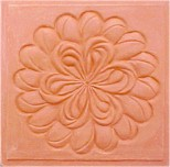 handmade terra cotta ceramic tile with a high relief design and a gloss or matte glaze