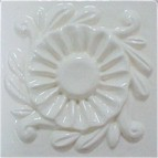 handmade ceramic tile with a high relief design and a multi-colored glaze