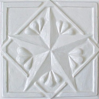 handmade ceramic tile with a high relief design and one color glaze