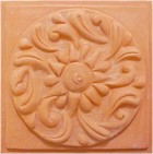 handmade terra cotta ceramic tile with a high relief design and a clear gloss or matte glaze